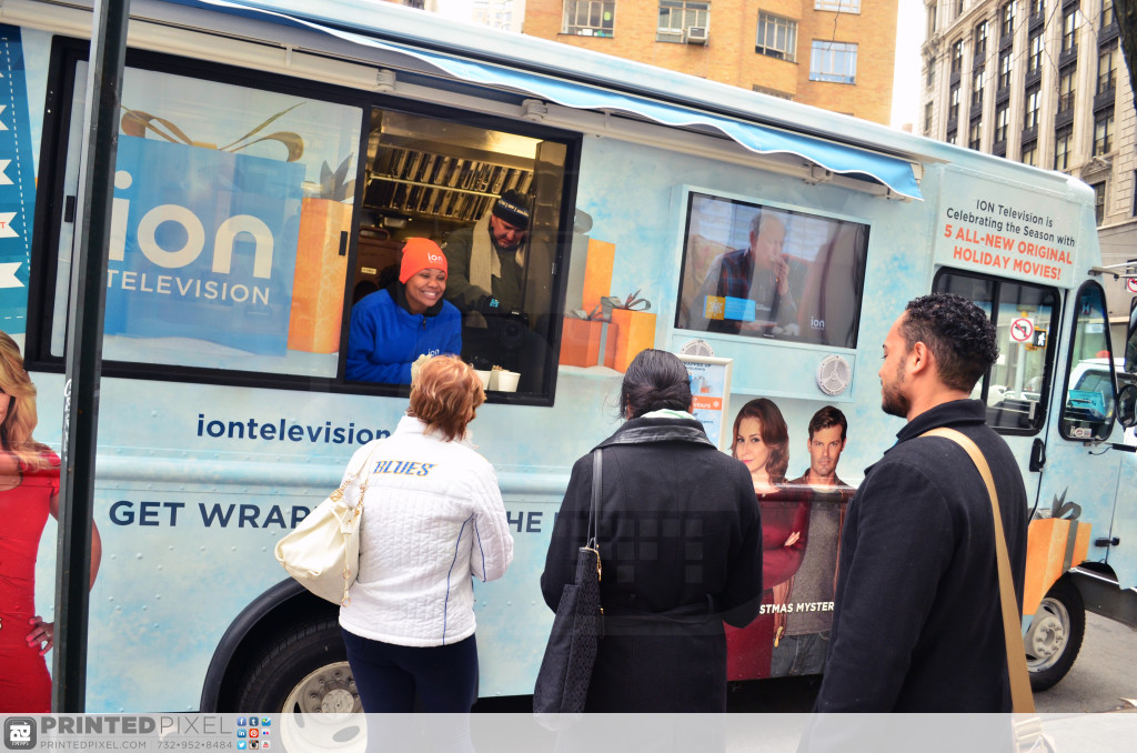 ION Television - Get Wrapped Up, serving sample products out of window