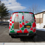 A photo taken from the rear of the van detailing the chocolate milk bottle with the green and red cow spots of Mama Fuscos van.