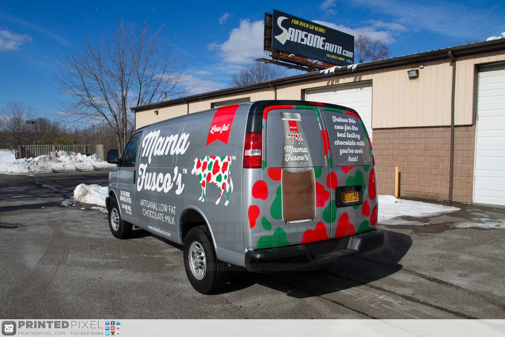 A wide angle shot detailing the driver side and rear of Mama Fuscos wrapped van.