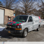 3/4 driver side view of Mama Fuscos wrapped van taken from the front.