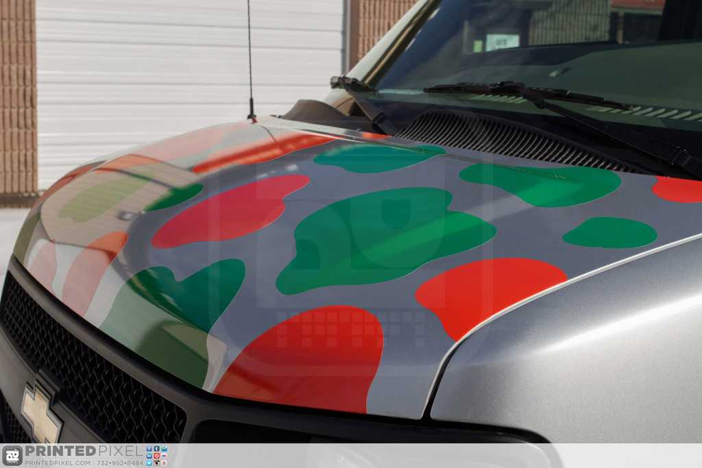 Close-up view of Mama Fuscos van wrap showing hood install details.
