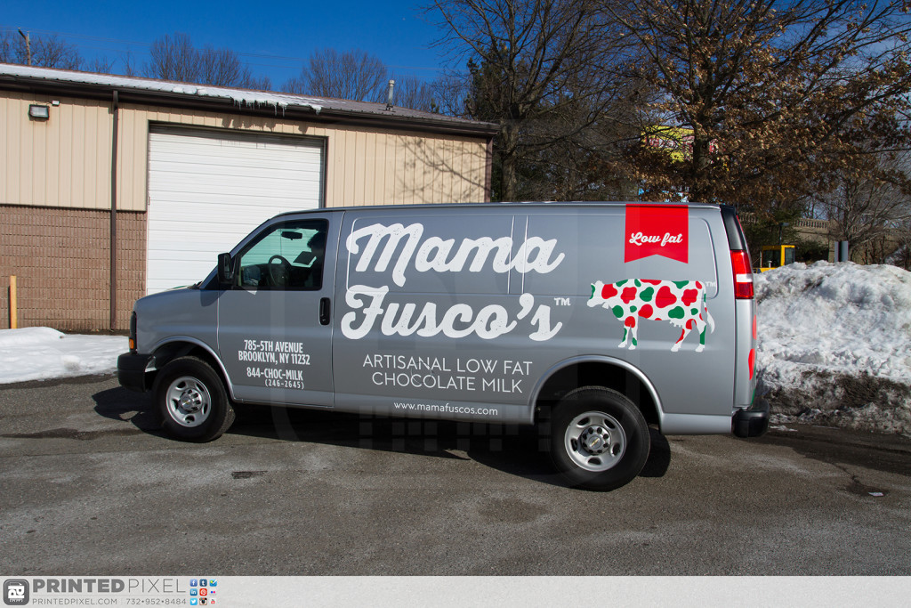 Driver side view of the Mama Fuscos wrapped van.
