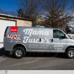 A full passenger side photo of Mama Fuscos van completly wrapped.