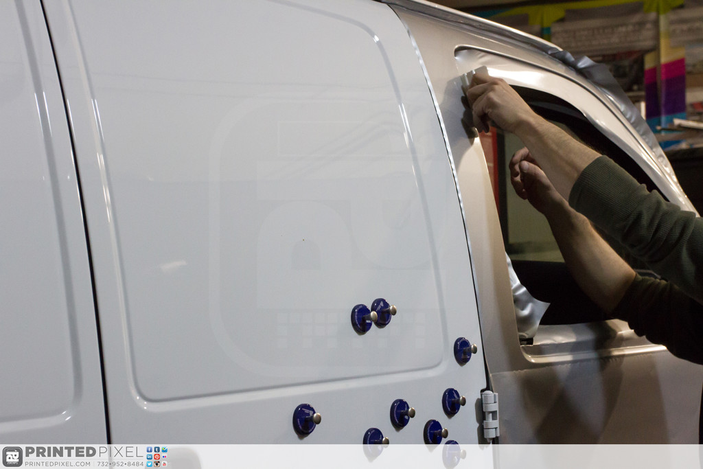 A close-up shot of the 3M 1080-G120 being installed on the white Mama Fuscos van.