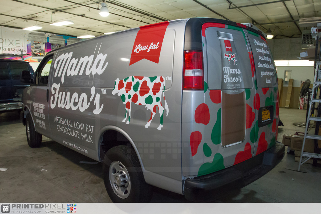 3/4 view of the driver side rear section of Mama Fuscos wrapped van.