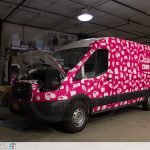 Claim it Ford Transit sampling vehicle fully wrapped. Front view.