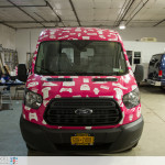 Claim it Ford Transit sampling vehicle fully wrapped. Front view inside Printed Pixel.