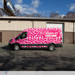 Claim it Ford Transit sampling vehicle fully wrapped. Driverside view.