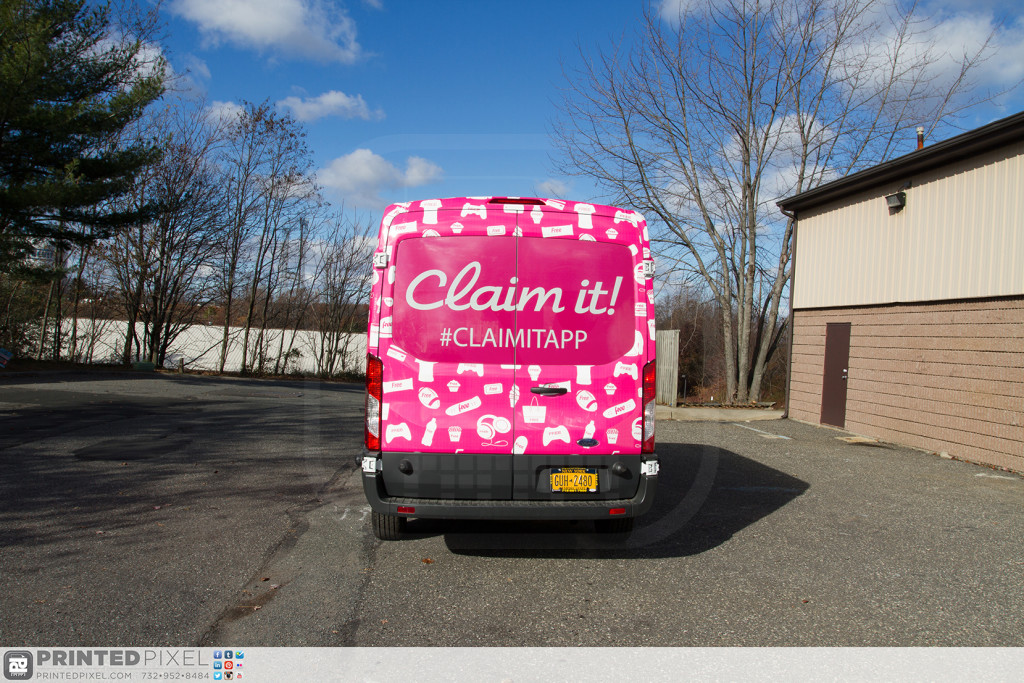 Claim it Ford Transit sampling vehicle fully wrapped. Rear view.
