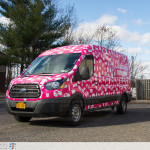 Claim it Ford Transit sampling vehicle fully wrapped outside.
